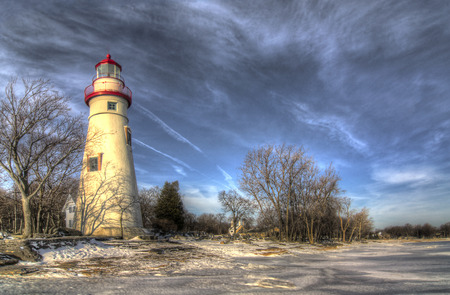 erie: The historic Marblehead Lighthouse in Northwest Ohio sits along the rocky shores of Lake Erie  Seen here in winter with snow and ice on the ground