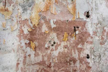 decaying: Photo of a colorful old decaying brick wall with peeling paint and stucco. Great for a background image or a texture.