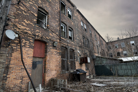 run down: An old run down brick building in an urban setting. Sadly these are seen frequently in American cites. Stock Photo
