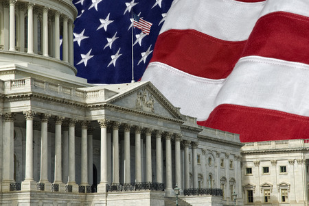 legislative: The United States Capitol Building in Washington DC with a U.S.A. flag in the background. A grunge effect has been applied. Stock Photo