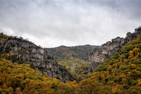 appalachian mountains: A scenic vista looking out over a rugged and craggy section of the Appalachian Mountains during peak autumn color. Stock Photo