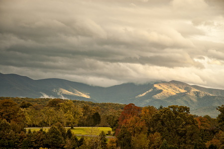 appalachian mountains: The beautifful Appalachian mountains in West Virginia  during autumn colors as the sun highlitghs the clouds.