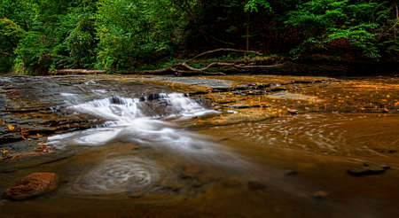 ohio: A small waterfall on Brandywine Creek in Cuyahoga Valley National Park Ohio.  Seen here in summer with low water flow. Stock Photo