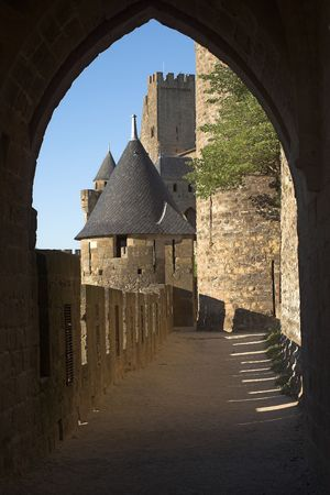 View at Carcassonne castle through an old stone archway