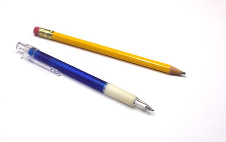 A ballpoint pen and a pencil on a white background; focused on pen tip Stock Photo