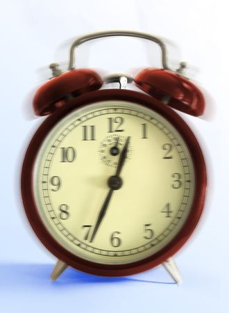 hectic life: Retro-styled alarm clock - close up on light blue background.