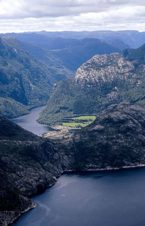 Picturesque view at Norwegian fjord photographed from Preikestolen rock (600m above the water). Stock Photo - 305326