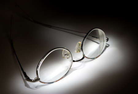 myopic: Glasses on white background in the darkness