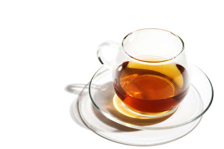 Transparent glass cup of tea on a white background