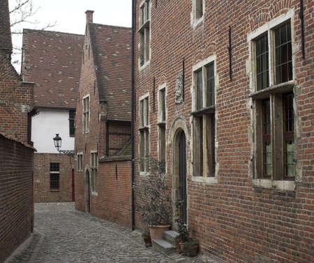 leuven: Narrow cobblestone street in a medieval quarter of the city of Leuven, Belgium.