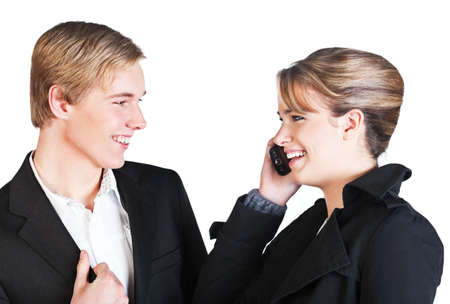 Young smiling woman with cellphone and young smiling man; isolated on white Stock Photo - 7771525
