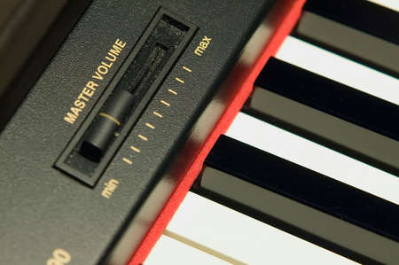 acoustically: electro piano keyboard with red stripe