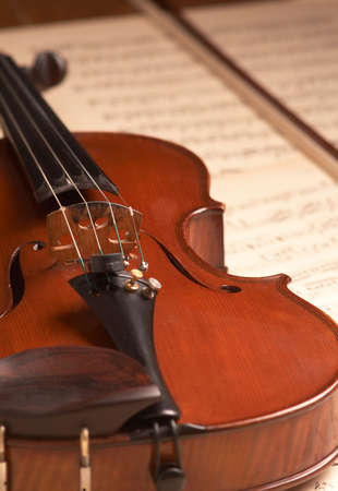 violine over music notes Stock Photo