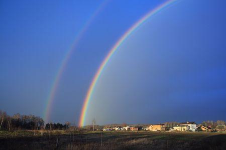 rainbow abive a houses