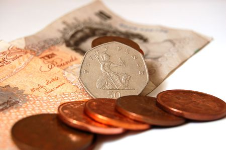 coppers: Fifty pence standing tall amongst, coppers and ten pound note.