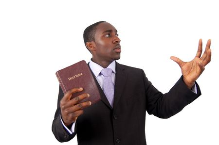 This is an image of man holding a bible. This image can be used to represent