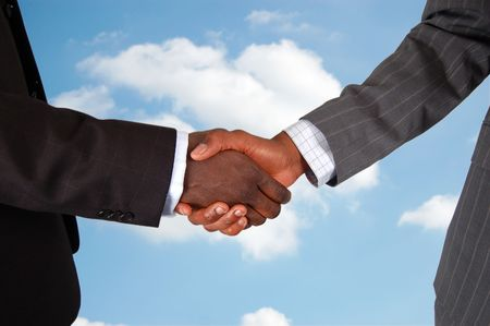unify: This is an image of two male bodies, representing businessmen in a handshake of agreement. Cloud background to represent deal from Heaven.