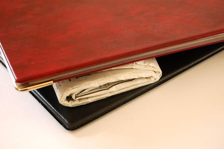 This is an image of a newspaper between a pair of portfolios photo