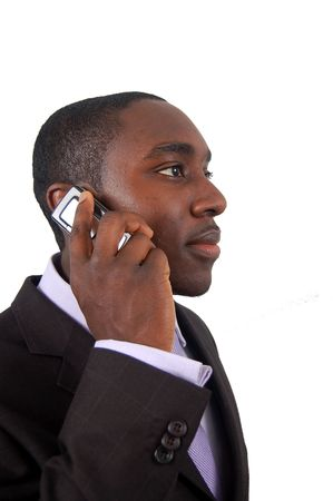 This is an image of a business man making a phone call. photo