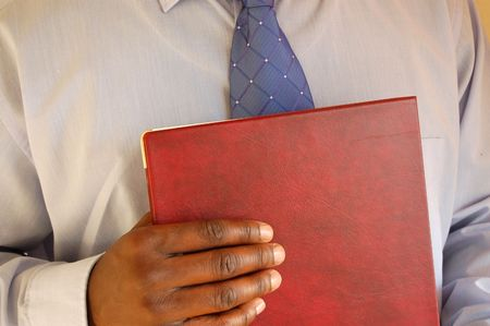 This is an image of businessman prepared for his interview.(portfolio in hand).