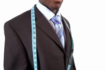 black business man: Ceci est une image d'un homme d'affaires noir, portant un ruban � mesurer.