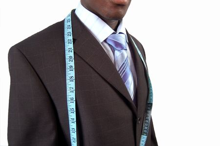 made to measure: This is an image of a black business man, wearing measuring tape.