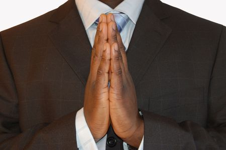 This is an image of a businessman making a prayer.