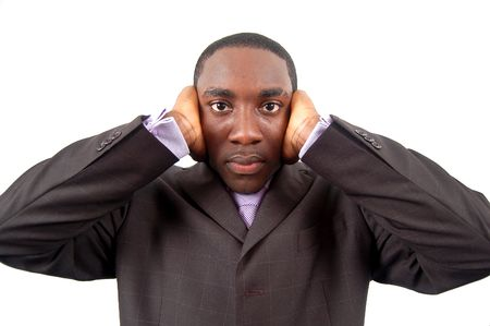 noise isolation: This is an image of a businessman with his hands on his ears. This is a metaphor for deaf business, unbearable business, noise, forced isolation etc..