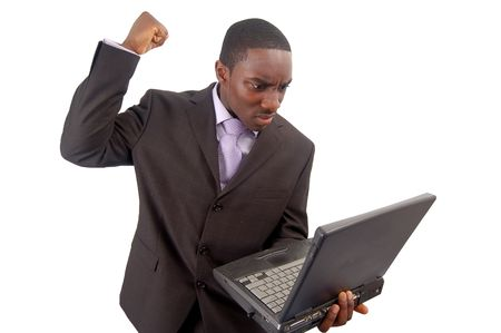 resent: This is an image of a businessman frustrated at his laptop. This image can be used to represent Stock Photo