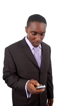 This is an image of a business man dialling from his mobilecellphone. photo