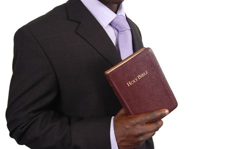 black jesus: This is an image of man holding a bible. Stock Photo