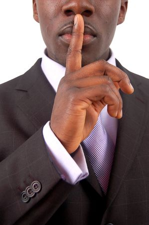 sigilo: This is an image of businessman with his hands on his lips. This posture implies secrecy, illegal business, trust etc..