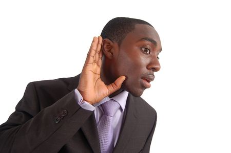 This is an image of a business man with his hand to his ear, as if to say Stock Photo
