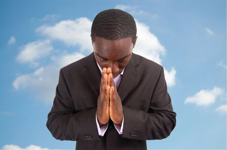 bowing head: This is an image of a business man bowing his head, as a sign of respect or in a gesture of praying. This can also represent