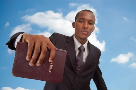 This is an image of man holding a bible. This image can be used to represent Heavenly message, sermon, preaching etc... photo