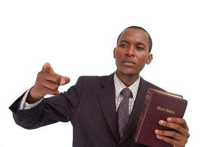 urge: This is an image of man holding a bible. This image can be used to represent sermon, preaching etc... Stock Photo