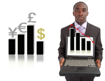 This is an image of businessman with laptop showing a projected fall in stock, and its effect on the world economy, represented by the graph behind.