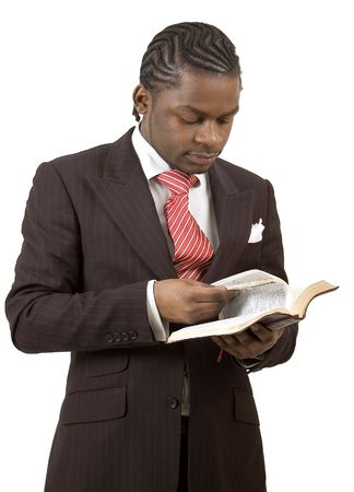 This is an image of a man posing with a bible. photo