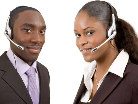 This is an image of a male and female call operator. This image can be used for telecommunication and service themes.   photo