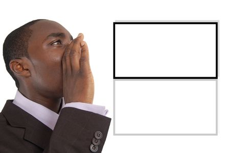 annoucement: This is an image of business man with his hands near his lips making an annoucement. The board in the background can be used for images and adverts. Stock Photo