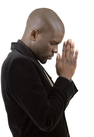 plead: This is an image of a businessman in a state of prayer. This image can be used to represent Peace Maker, Faith , Business Vision etc... Stock Photo