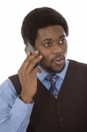 This is an image of a businessman having a conversation on his mobile phone. photo