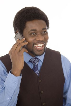 rescheduling: This is an image of a businessman cheerfully having a conversation on his mobile phone.
