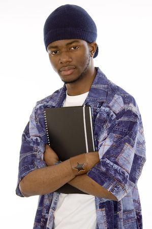 This is an image of a student holding a notepad with his arms crossed. This image can be used to represent student themes. Stock Photo - 1605859