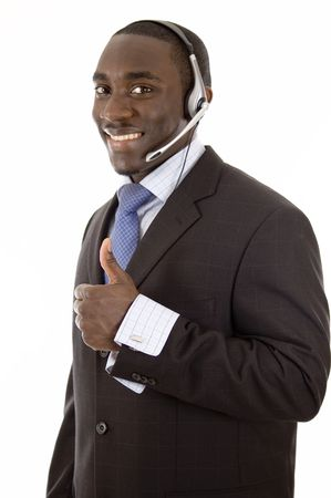 This is an image of a man with a microphone headset, giving thumbs up. This image can be used for telecommunication and service themes.