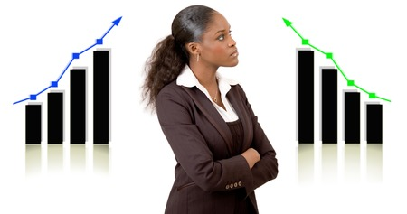 This is an image of a businesswoman in front of two graphs planning for success. This image can be used to represent Planning Successs themes.