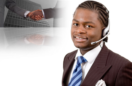 This is an image of a businessman with a microphone headset. This image can be used for telecommunication and business themes. photo