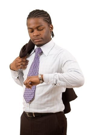 to ensure: This is an image of a black businessman checking the time.