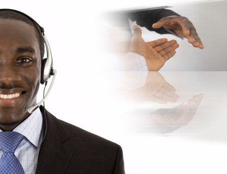 This is an image of a man with a microphone headset on, with conceptual handshake in the background. Stock Photo
