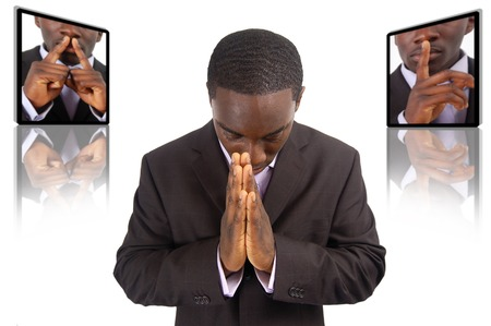 This is an image of businessman emphasising the need for silence, during prayer time.
